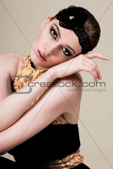 Attractive Young Woman Wearing Black and Gold