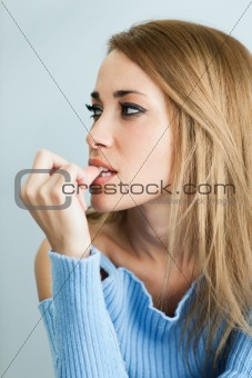 worried woman biting her nails