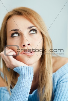 pensive woman biting lips