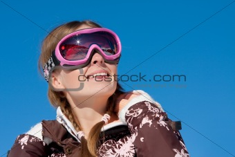Skier looking up and smiling