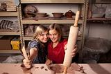 Cute young girls in clay studio