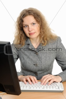 Business woman portrait smiling in front of her desktop computer