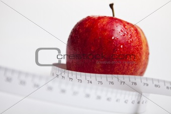 Apple and measurement tape