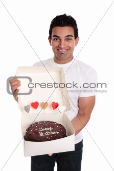 Adult man holding a chocolate birthday cake
