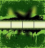 Filmstrip on green grunge background