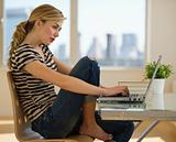 female working on computer at home