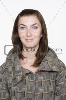 Portrait of Young Woman Wearing Coat. Isolated.