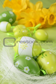Green Easter eggs and daffodils