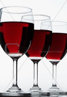 Three red wine glasses