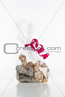 assortment of delicious chocolate truffles in bag with red ribbon