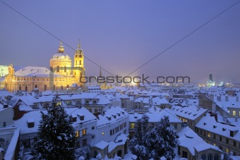 prague - st. nicolaus church and rooftops of mala strana in winter