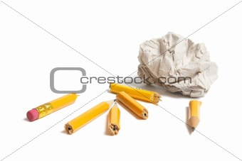 Broken Pencil Pieces and Paper Ball