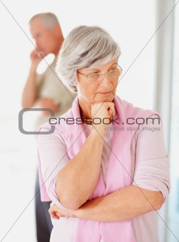 Senior lady and her husband looking away after an argument