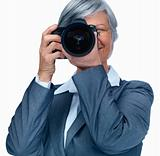 Woman taking out a photograph while isolated on white