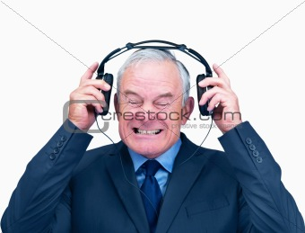 Elderly man with headphones that is playing very loud music