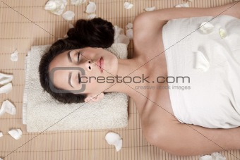 Attractive woman getting flower spa treatment