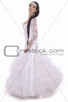 Beautiful lady dressed in wedding costume