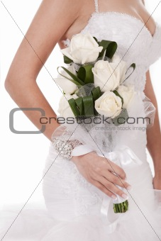 Bride with bunch of white roses