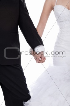 Bride and groom hands holded together