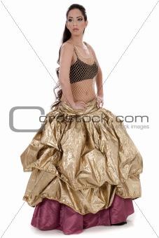 Beautiful blond belly dancer in golden costume dancing
