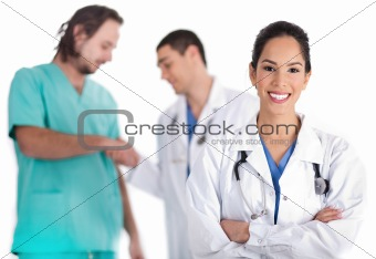 Attractive young doctor smiling, other doctor giving shake hand to male nurse