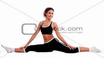 Fitness girl sitting and streching her legs both sides