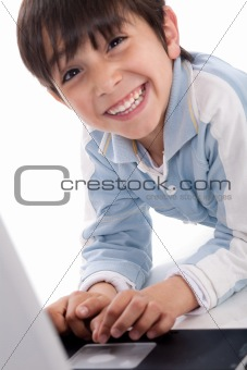 Portrait of cute caucasian boy smiling with laptop