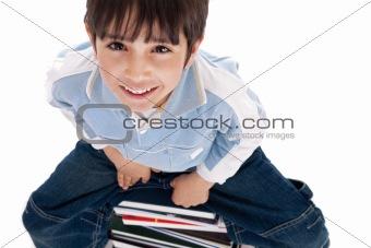 Top angle image of kid sitting on books