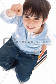 Top view of cute kid with fingers up sitting on books