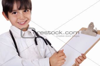 Little boy doctor writes on his clipboard for diagnosis