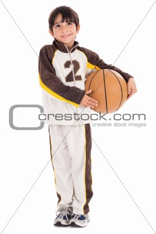 Adorable young kid in his sports dress with basketball