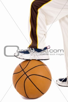 A small kid leg over the ball