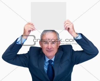 Smiling business man holding empty billboard over head