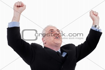Champion senior business man standing with fists clenched in victory