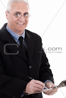 Portrait of smiling business man writing on pad