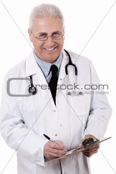 Portrait of senior doctor writing reports