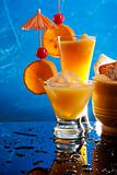 Orange party drinks on blue