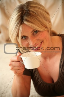 Portrait of Young Woman Having a Cup of Coffee