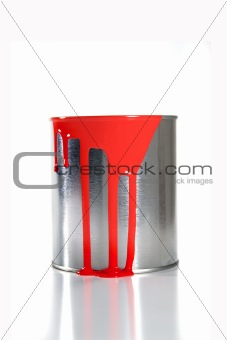 a messy red paint bucket