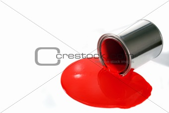 a spilled red paint bucket