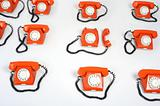 Large group of orange telephones