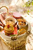 Pancakes and sweets in basket