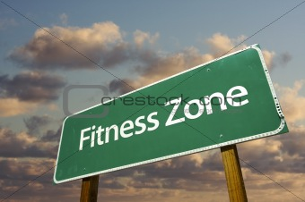 Fitness Zone Green Road Sign In Front of Dramatic Clouds and Sky.