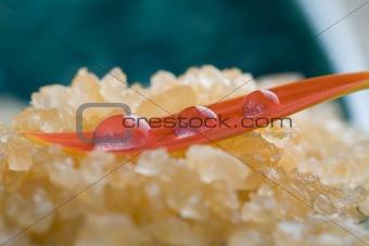 Bath salt with water droplets on flower petal