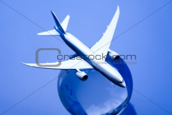 Airliner with earth in the blue background