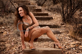 Portrait of pretty woman outdoors on wooden steps
