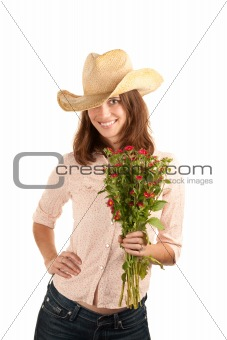 Pretty young brunette woman with cowboy hat and flowers