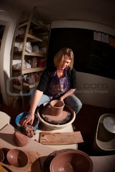 Fisheye shot of potter shaping clay