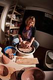Fisheye shot of potter shaping clay