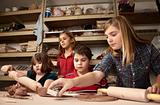 Children in a clay studio